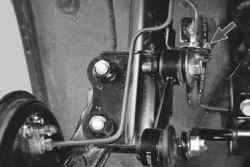 Снятие и установка телескопической стойки задней подвески
